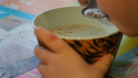 Children`s breakfast with milk stock video footage