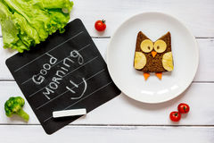 Children's breakfast owl shaped sandwich good morning Stock Photos