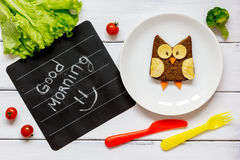 Children`s breakfast owl shaped sandwich good morning Stock Photography