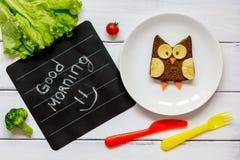 Children`s breakfast owl shaped sandwich good morning Stock Image