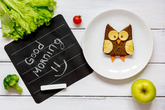 Children`s breakfast owl shaped sandwich good morning Royalty Free Stock Image