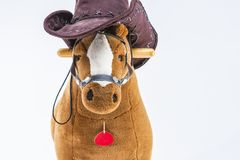 Children`s Brown Plush Toy Horse With Natural Cowboy Stetson. Pl. Aced Against White Background. Horizontal Image Stock Photography