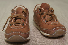 Children's brown shoes on the floor Stock Photos