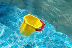 The children's bucket floats Stock Photos