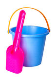 Children's bucket and shovel, isolated. Children's bucket and shovel, isolated on a white background Royalty Free Stock Image