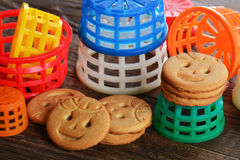 Childrens butter cookies and colorful toys Royalty Free Stock Images