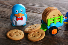 Childrens butter cookies and vehicle toy Royalty Free Stock Photo