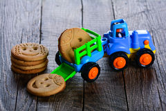 Childrens butter cookies and vehicle toy Stock Photo