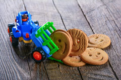 Childrens butter cookies and vehicle toy Stock Images