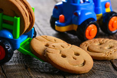 Childrens butter cookies and vehicle toy Stock Image