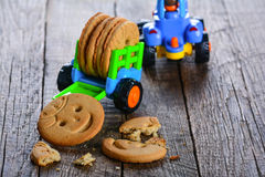 Childrens butter cookies and vehicle toy Stock Photography