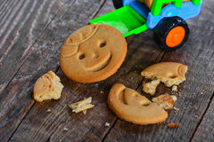 Childrens butter cookies and vehicle toy Royalty Free Stock Photos