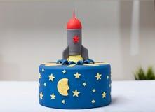 Children's cake rocket the blue Royalty Free Stock Photo