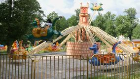 Children`s carousel in the amusement park. 4k stock footage