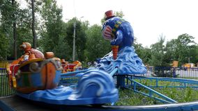 Children`s carousel in the amusement Park stock footage