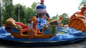Children`s carousel in the amusement Park stock video footage
