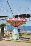 Children`s carousel at the Boulevard in Batumi on a Sunny day. Batumi. Georgia. royalty free stock photos