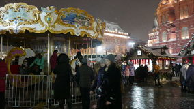 Children's Carousel at the Christmas Fair in Moscow. stock video footage