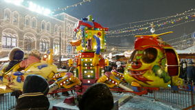 Children's Carousel at the Christmas Fair in Moscow. stock video