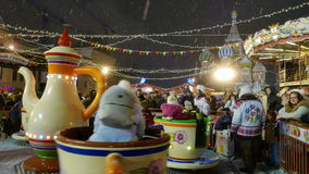 Children's Carousel at the Christmas Fair in Moscow. stock footage