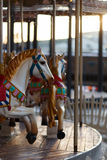 Children`s carousel with horses outdoor Royalty Free Stock Photo