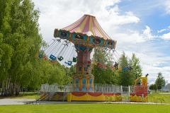 Children`s carousel in the park on a summer day. Cheboksary. Russia. June 10, 2018: Children`s carousel in the park on a summer day. Cheboksary. Russia royalty free stock images