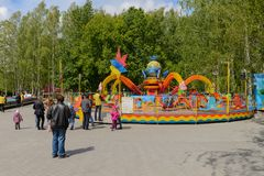 Children`s carousel in the park on a summer day. Cheboksary. Russia. June 10, 2018: Children`s carousel in the park on a summer day. Cheboksary. Russia royalty free stock photos