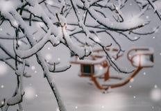 Children`s carousel in winter Park Stock Photo