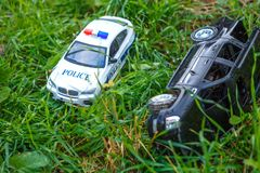 Children`s cars on the grass police and jeep stock image
