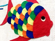 Children's chore, cloth fish. Colorful fish made for children. This is a chore that is done at school with pieces of colored cloth. The fabric is glued onto royalty free stock image