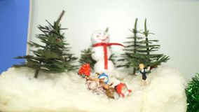 Children`s Christmas crafts snowman in the winter forest with toys. children`s holiday concept. Close-up stock footage
