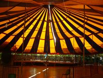Children`s circus tent, sun effects on the roof. Armored circus tent for children, the effects of the sun`s rays in the roof tent, make a scene of light stock photography