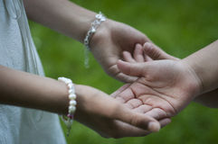 Children's clasped hands Stock Image
