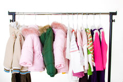 Children's clothes. On a hanger in assortment, sale of stock images