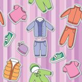 Children's clothes. Seamless pattern of children's clothes on violet background Stock Photography