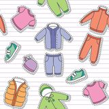 Children's clothes. Seamless pattern of children's clothes on white striped background Stock Photo