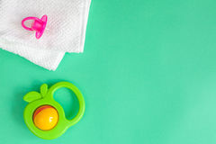 Children`s clothes and baby booties on green background. Top view Stock Images