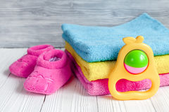 Children`s clothes and baby booties on wooden background. Top view Royalty Free Stock Image