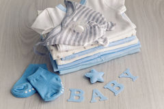 Children`s clothes with the diapers are stacked Royalty Free Stock Photos