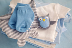 Children`s clothes with the diapers are stacked Stock Image