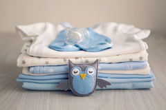 Children`s clothes with the diapers are stacked Stock Images