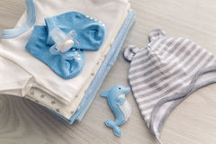 Children`s clothes with the diapers are stacked Stock Photo