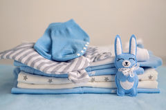 Children`s clothes with the diapers are stacked Stock Photography