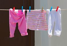 Children`s clothes are dried outdoors.  Stock Photography