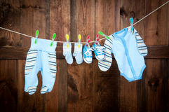 Children's clothes drying on the clothesline. Royalty Free Stock Photography