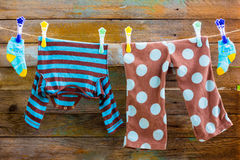 Free Children S Clothes On A Rope Royalty Free Stock Photo - 64629115
