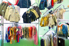 Children's clothes in a shop Royalty Free Stock Images