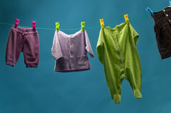 Children's clothing hanging on a rope Stock Photography
