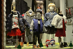 Children's clothing in shop window, in Christmas Royalty Free Stock Image