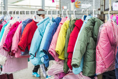 Children's clothing store at a flea market. Badalona, Spain - November 1, 2014: Stall clothes in the market Turo Caritg in Badalona, a town next to Barcelona Royalty Free Stock Photos